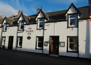 A photograph of the Village Inn on Bay Street